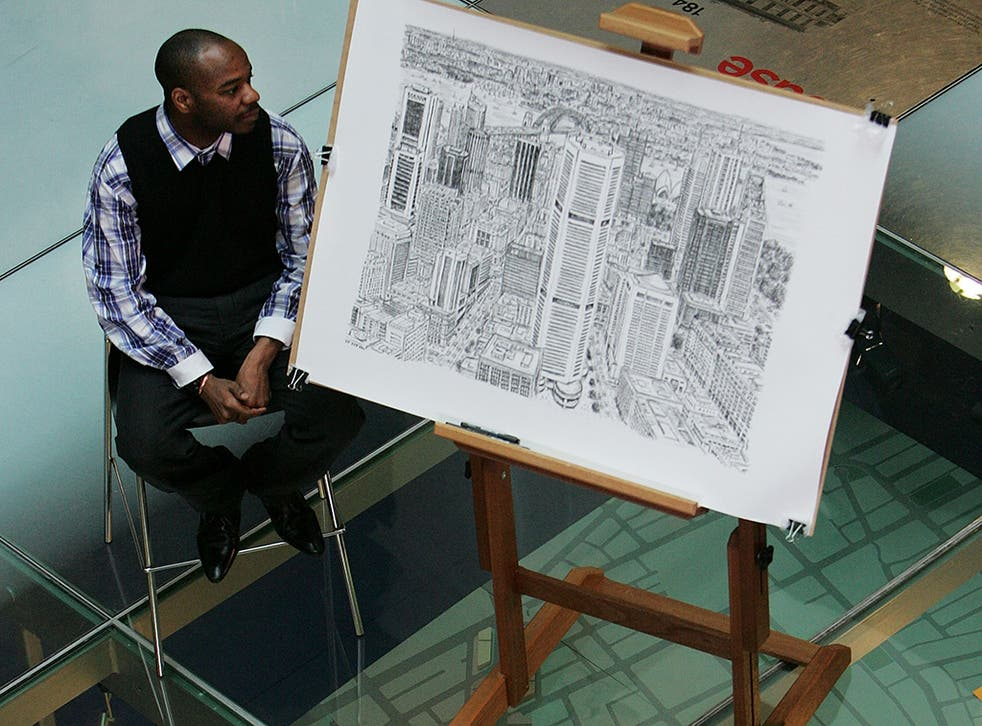 British artist Stephen Wiltshire sits with his detailed sketch of the Sydney cityscape during a press conference at Customs House on April 30, 2010 in Sydney, Australia. Diagnosed with autism at the age of three, 36-year-old Wiltshire has the ability to d