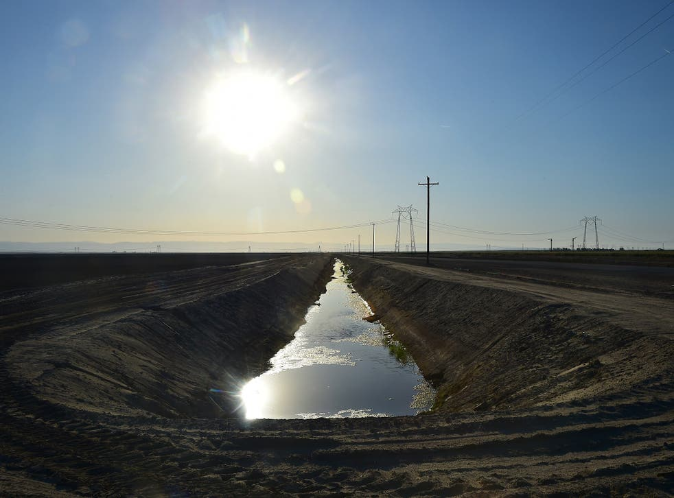 Water flows along an aqueduct beneath the sweltering sun in Kern County, California. The state's drought, now in its fourth year, is going from bad to worse
