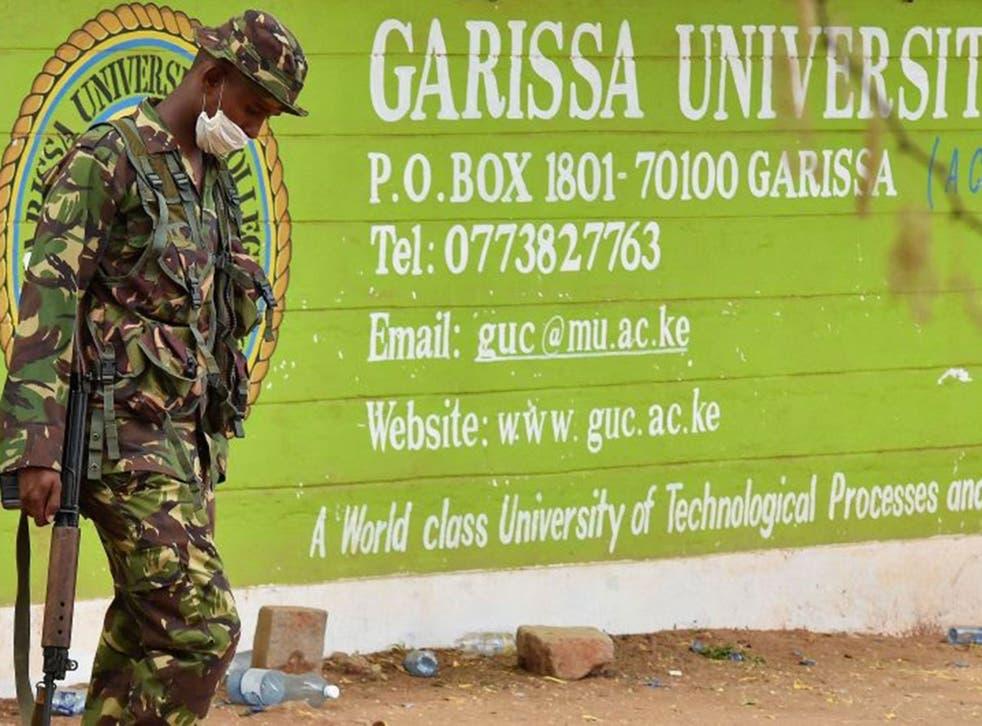 A Kenya Defence forces soldier walks past the front entrance of  Garissa University College on April 3