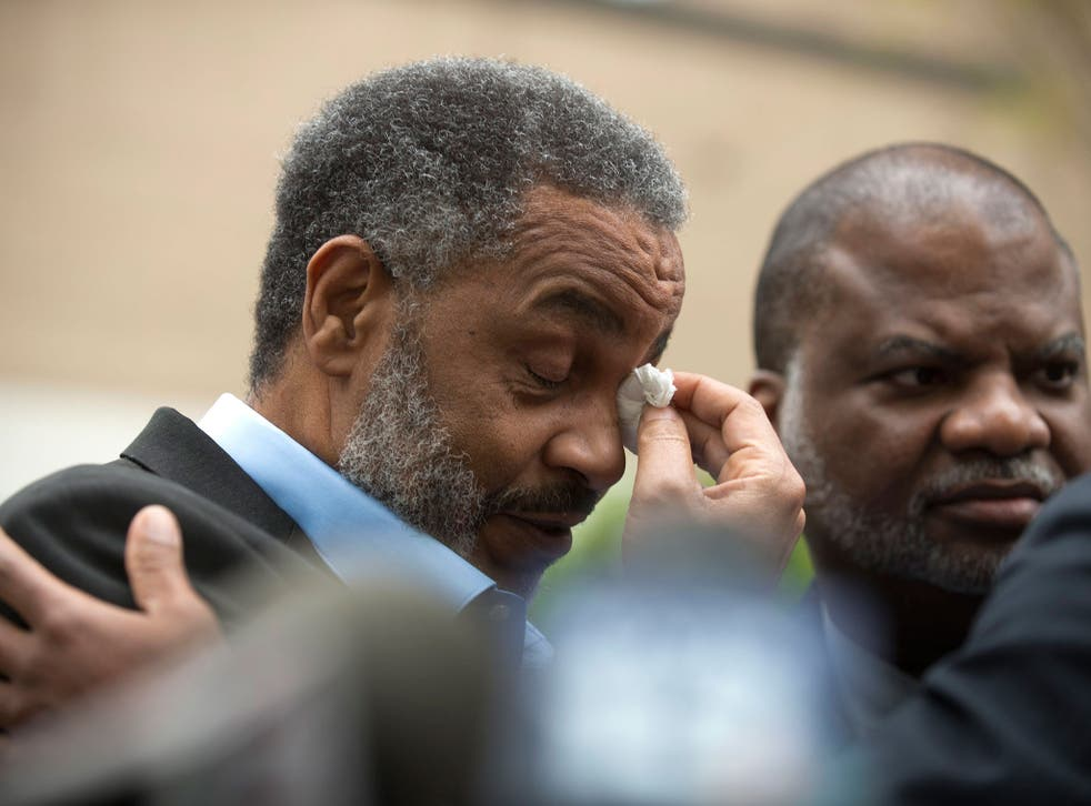 Anthony Ray Hinton wipes away tears outside of the Jefferson County Jail upon his release after serving 28 years on death row, in Birmingham, Alabama