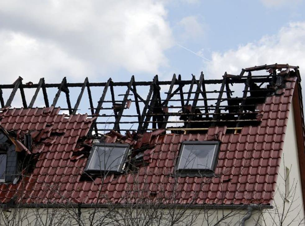 A building set to be used as an asylum seekers' home was damaged by fire
