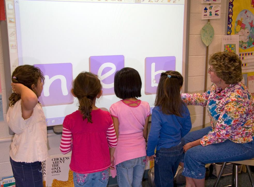 Four-year-olds are too young to be tested, say teachers, because they don't have the necessary attention span