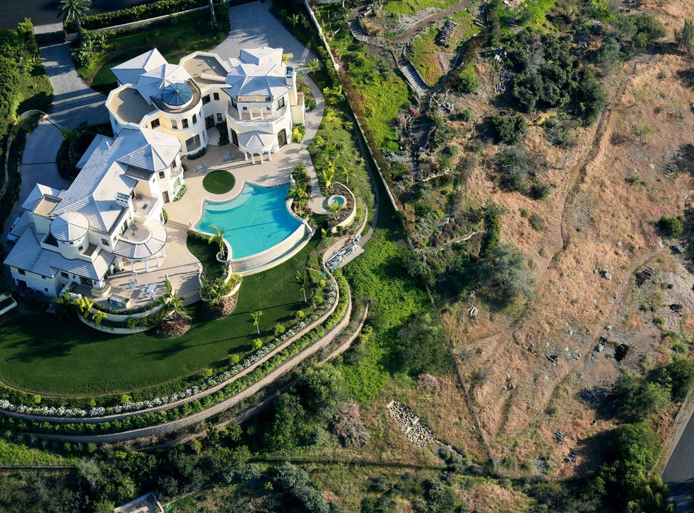 The stark contrast between watered lawns and brown hillside in San Diego