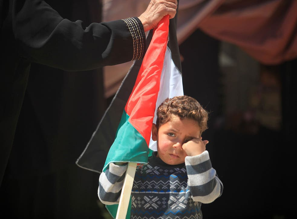 A Palestinian child pictured during a gathering in front of the UN headquarters in Gaza City in solidarity with Palestinians living in Syria's Yarmouk camp (6 April, 2015)