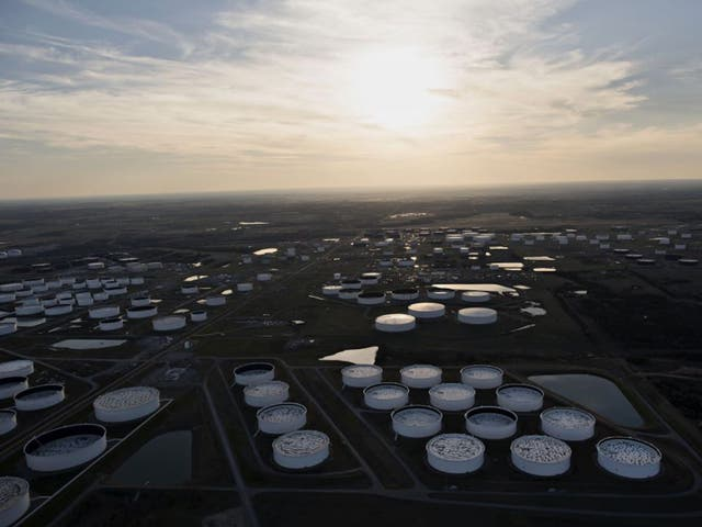 Oil storage tanks in Cushing, Oklahoma, located at the convergence of several pipelines; the number of earthquakes above 3.0 on the Richter scale has risen from two in 2008 to 585 in 2014