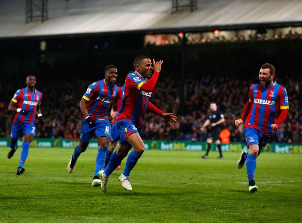 Jason Puncheon celebrates scoring for Palace while Manuel Pellegrini holds his head