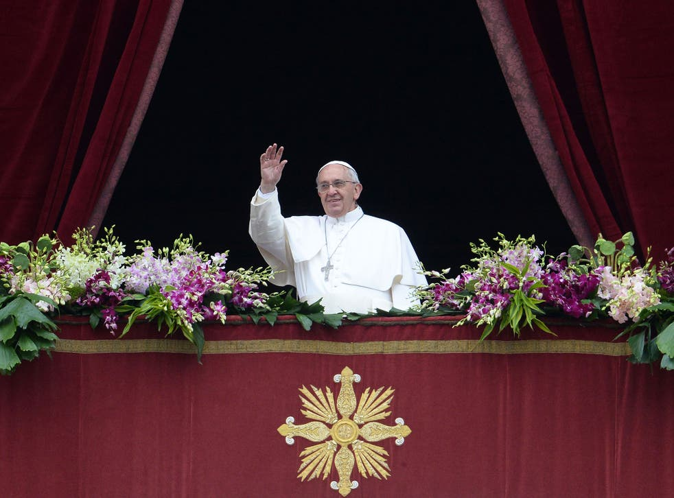 """Pope Francis greets the crowd from the central loggia of St Peters' basilica after the """"Urbi et Orbi"""" blessing for Rome and the world following the Easter Mass in Vatican"""
