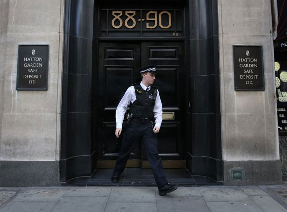 A policeman emerges from a Hatton Garden safe deposit centre on April 7, 2015 in London, England.