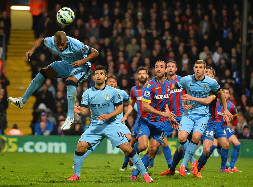 Manchester City's Brazilian midfielder Fernandinho (L) jumps to win a header during the English Premier League football match between Crystal Palace and Manchester City at Selhurst Park in south London
