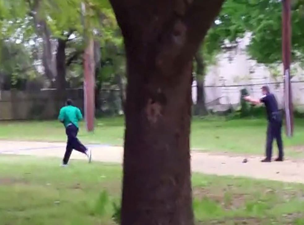 Michael Slager is seen apparently firing on Walter Scott as he runs away