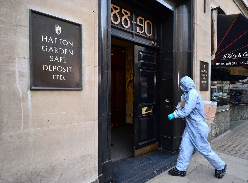 """A police forensics officer entering the Hatton Garden Safe Deposit company in London, as detectives continued to determine the scale of a heist at a safety deposit centre as victims hope to learn whether their jewels and cash are among the """"huge"""" haul sto"""