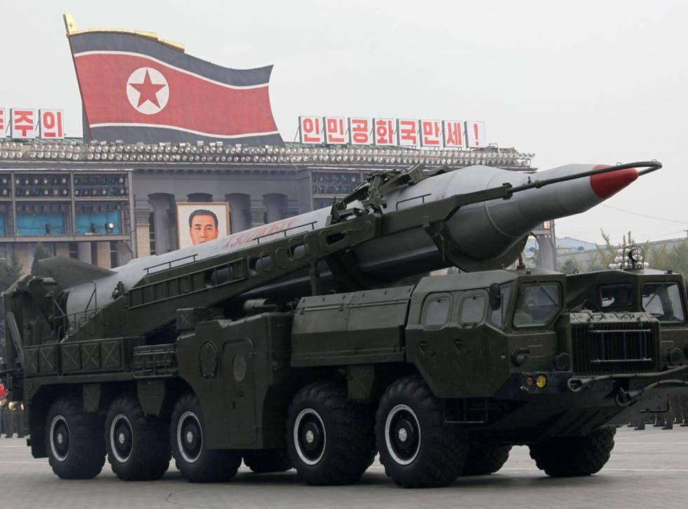 North Korean missiles on trucks make their way during a massive military parade to mark the 65th anniversary of the communist nation's ruling Workers' Party in Pyongyang