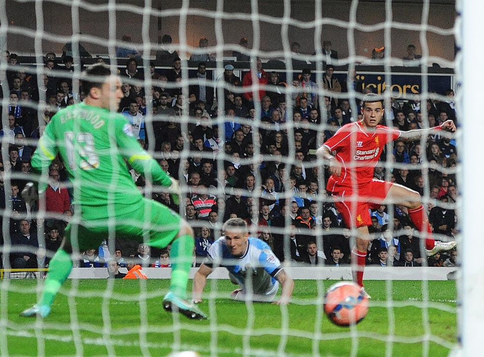 Philippe Coutinho finds the bottom corner to book Liverpool's place in the semis