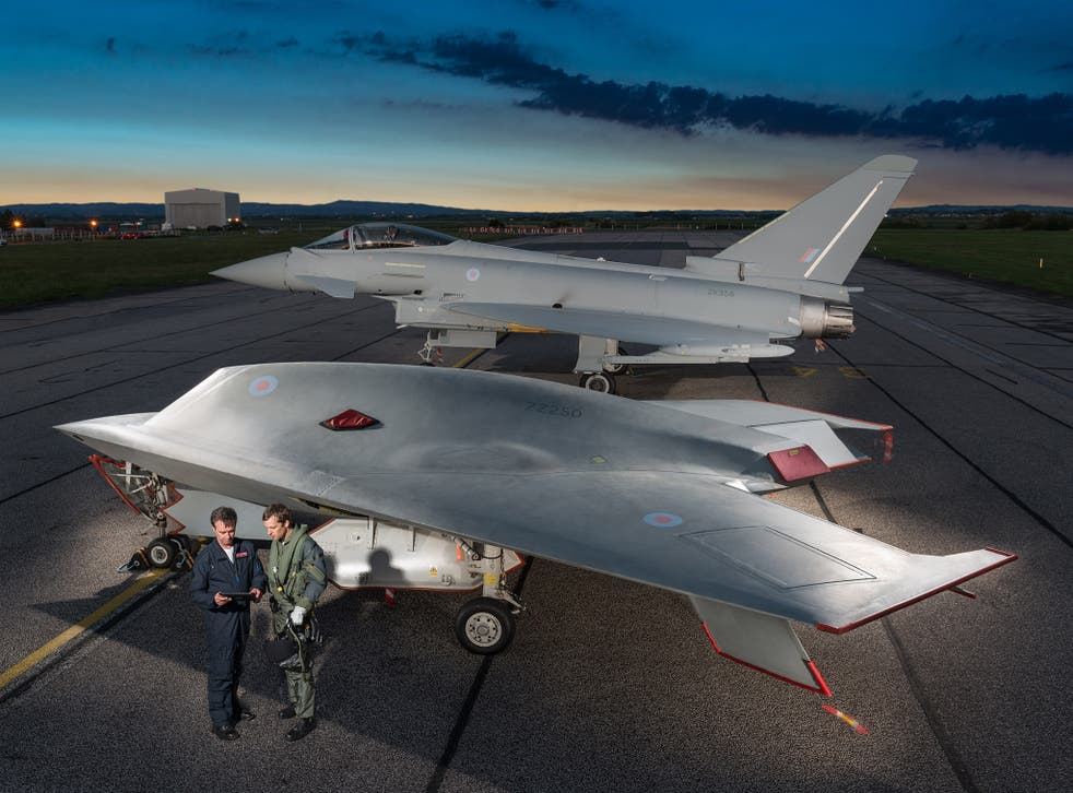 An unmanned Taranis drone (nicknamed Raptor) in front of a piloted fighter jet