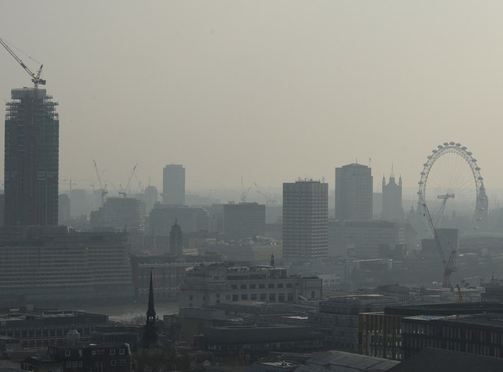 Air pollution obscures the view of the London eye in central London on 9 April 2015
