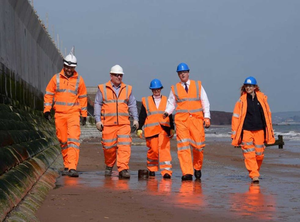 Prime Minister David Cameron meets construction workers at Dawlish in Devon where saw work on the improved sea defences