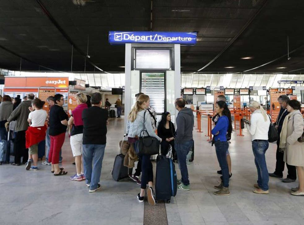 People queue at Nice's airport, southeastern France