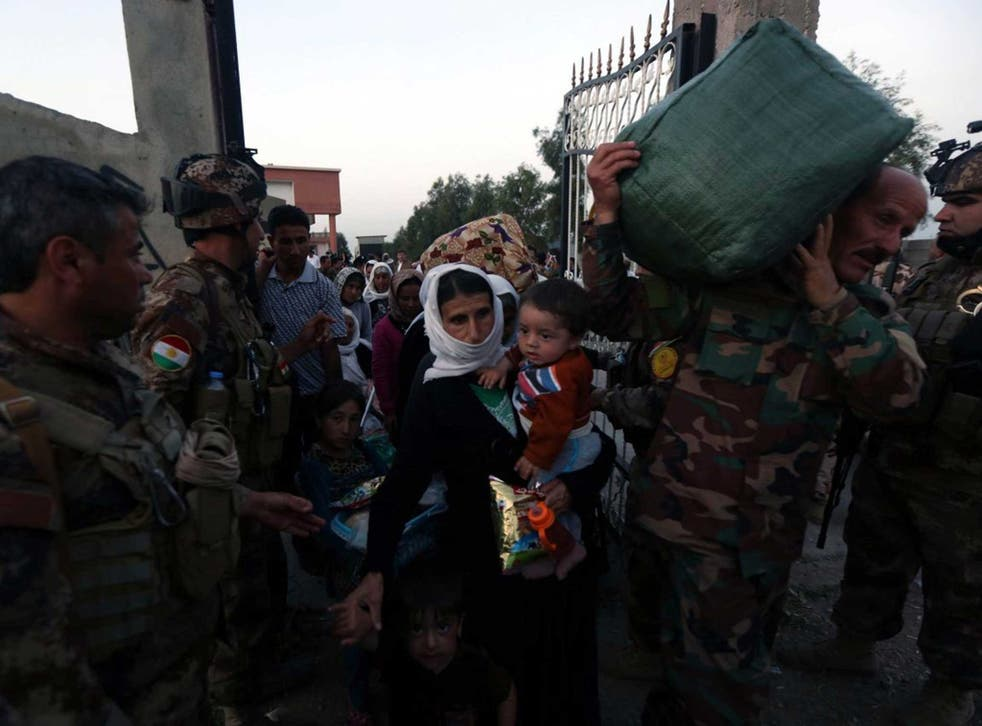 Peshmerga forces help Yazidis freed by Isis in northern Iraq earlier this week