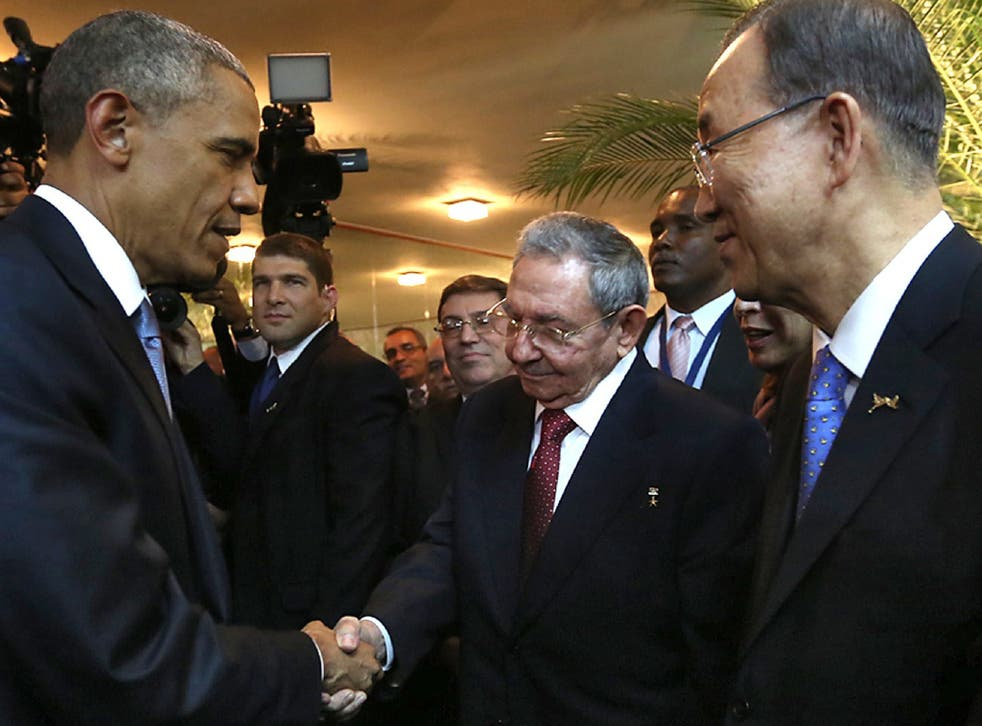 Raul Castro and Barack Obama shake hands at the Summit of the Americas