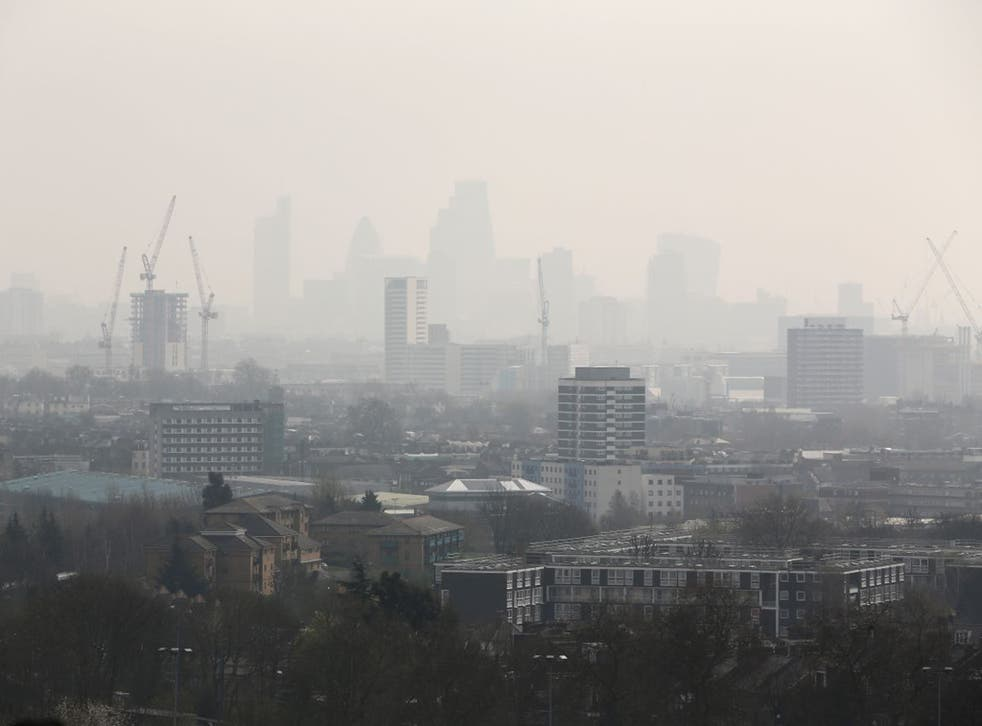 Smog blanketed much of central and southern England on Friday, including the City of London
