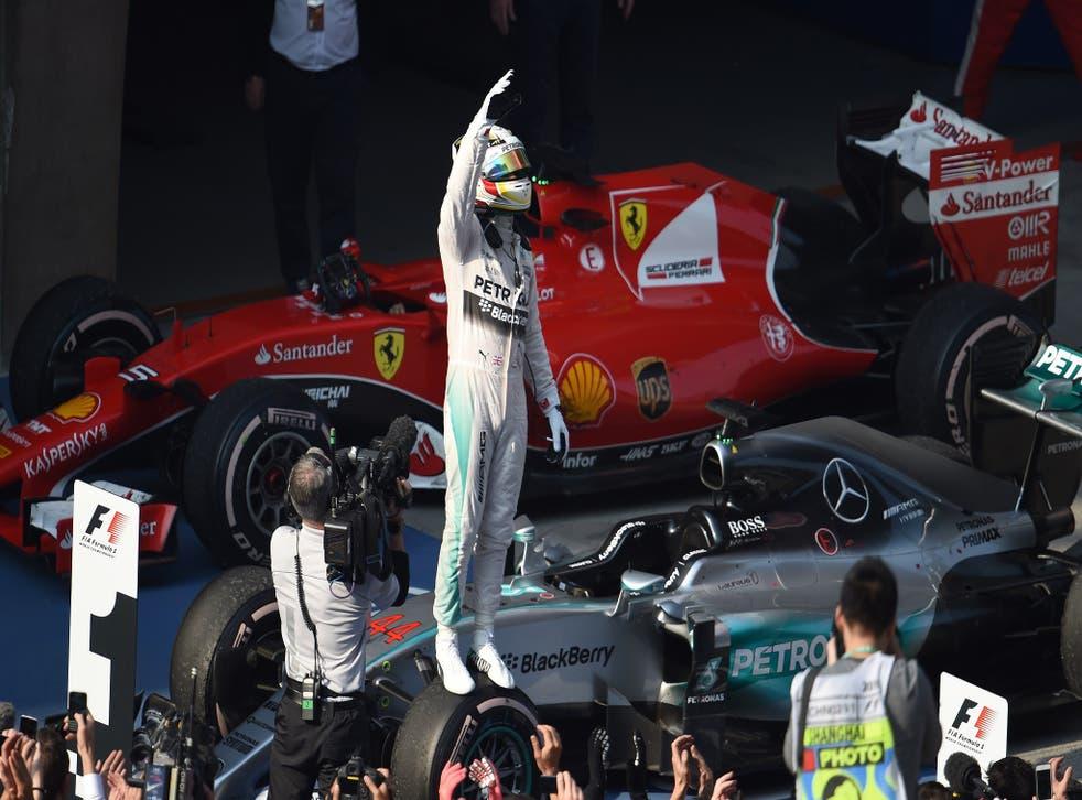 Lewis Hamilton celebrates winning the Chinese Grand Prix