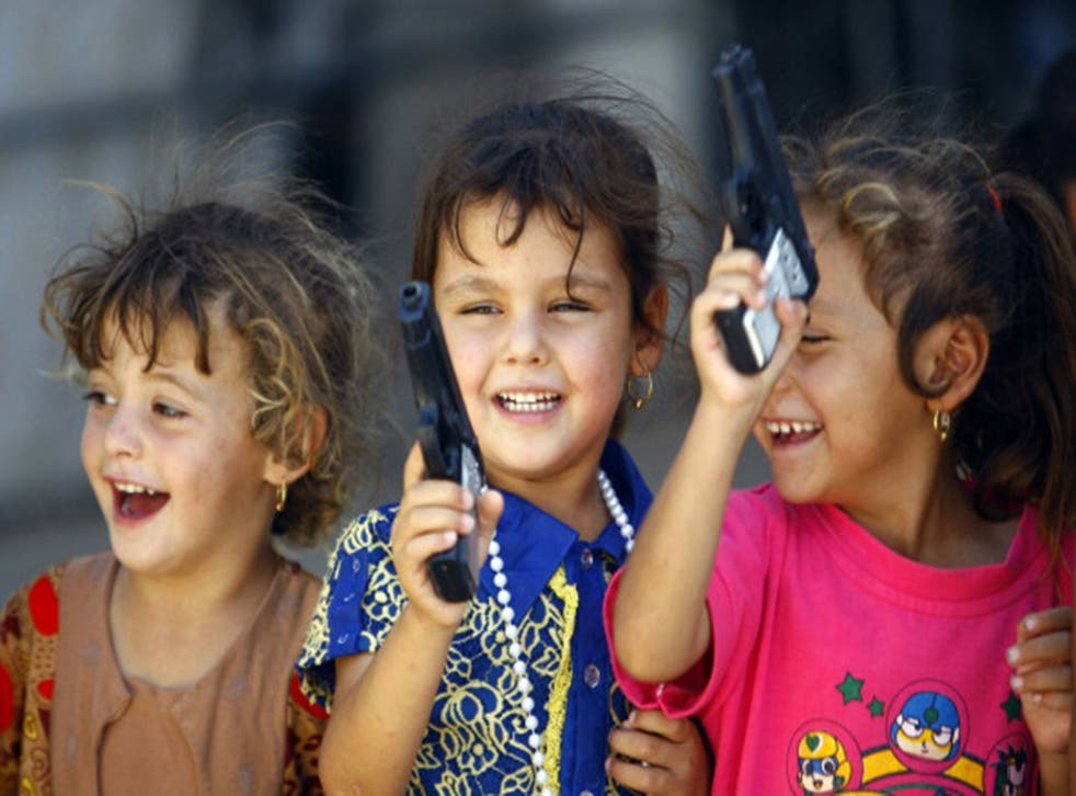 Iraqi Shiite children  from Mosul play with toy guns