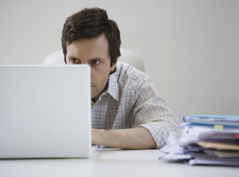 Look familiar? A man slouches over his computer
