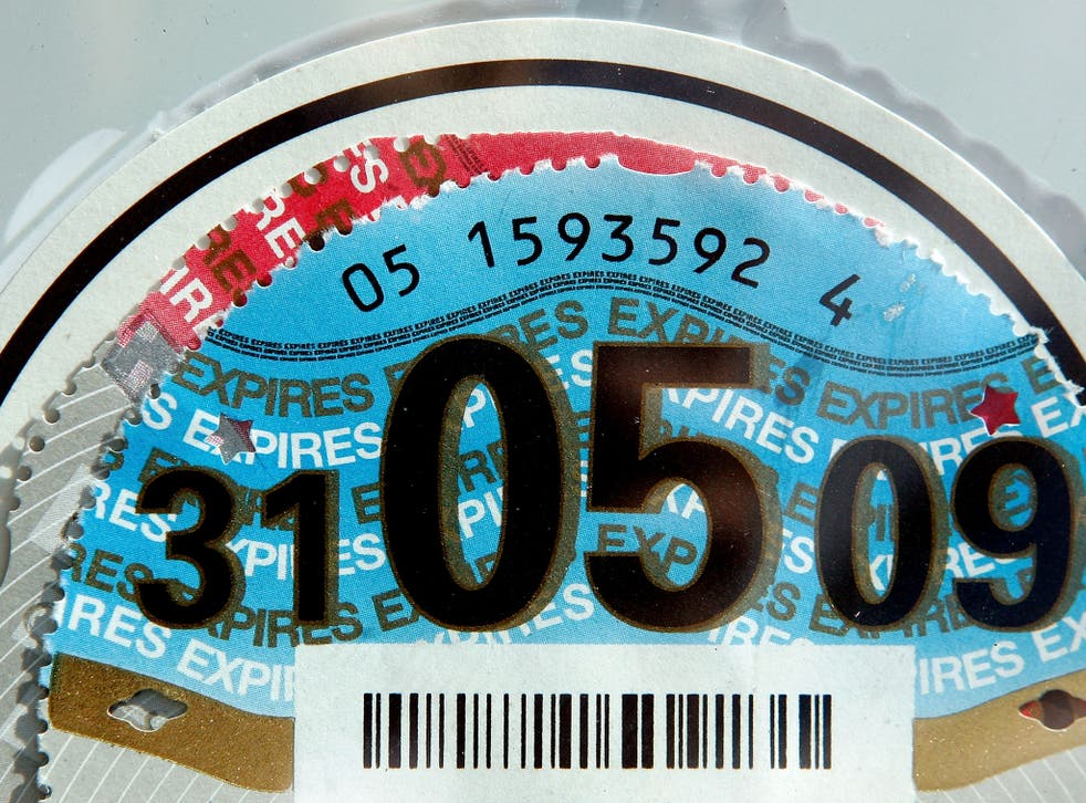 A 2008/ 2009 car tax disc is on display in a car windscreen on August 4, 2008 in London, England. Some MPs believe plans for new increased car tax rates on high fuel consumption vehicles should be made bolder to ensure a more effective impact on the envir
