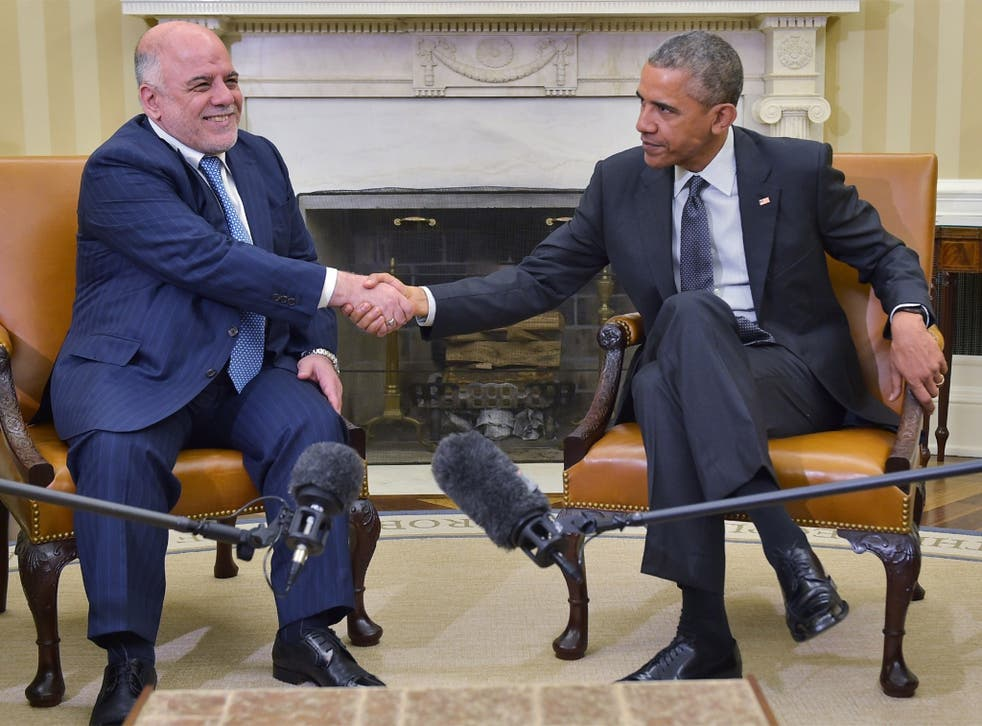 Barack Obama shakes hands with Haider al-Abadi on Tuesday