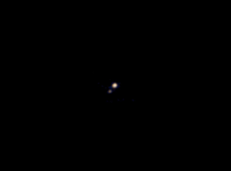 This image of Pluto and its largest moon, Charon, was taken by the Ralph color imager aboard NASA's New Horizons spacecraft on April 9 and downlinked to Earth the following day. It is the first color image ever made of the Pluto system by a spacecraft on