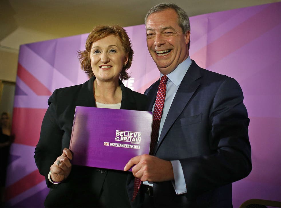Ukip leader Nigel Farage and deputy chairman, Suzanne Evans, pose with the party manifesto during its launch in Thurrock