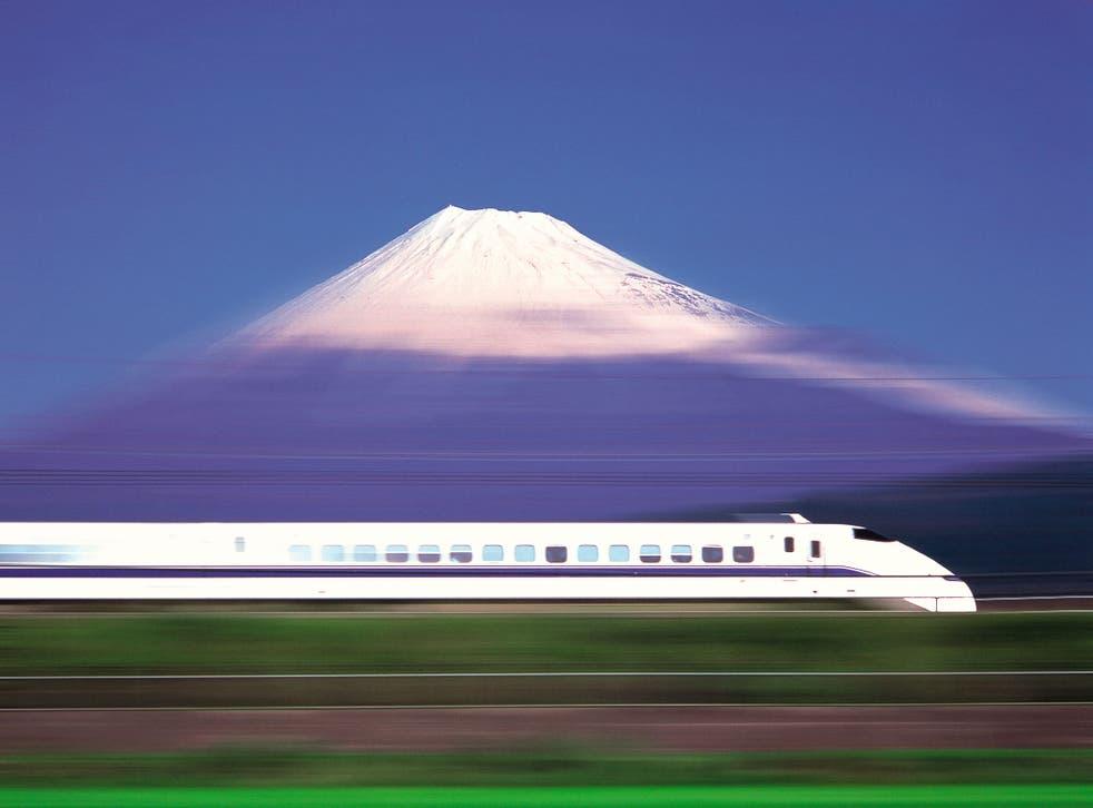 A bullet train races past Mount Fuji
