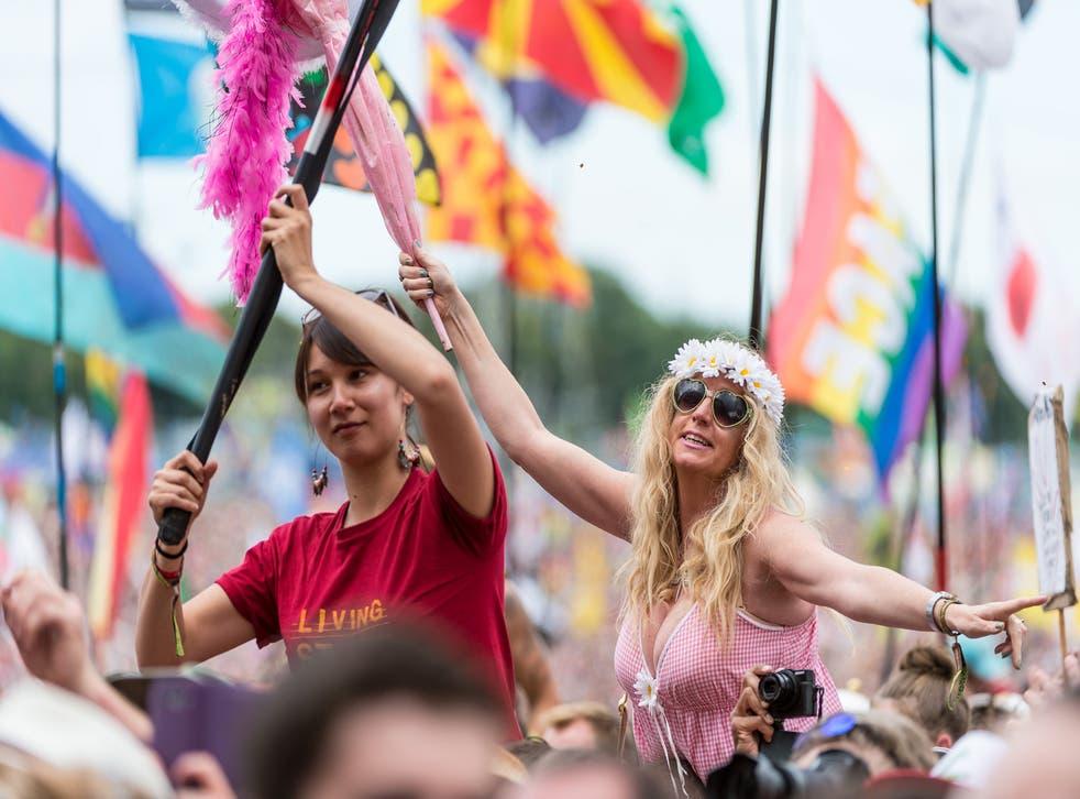 Festival-goers soak up the atmosphere at Glastonbury 2014