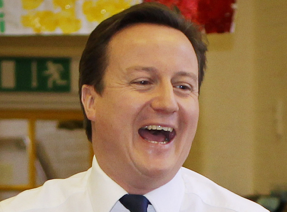David Cameron laughs while maintaining his usual sexy demeanour