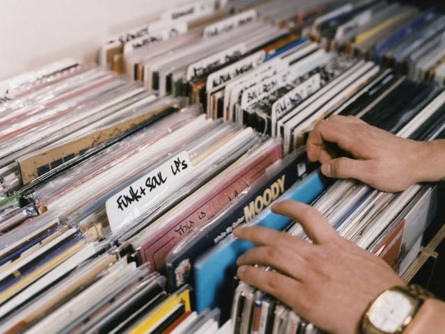 Art on their sleeves: before downloads and streaming, enthusiasts used to flick through racks of albums in their local record shops