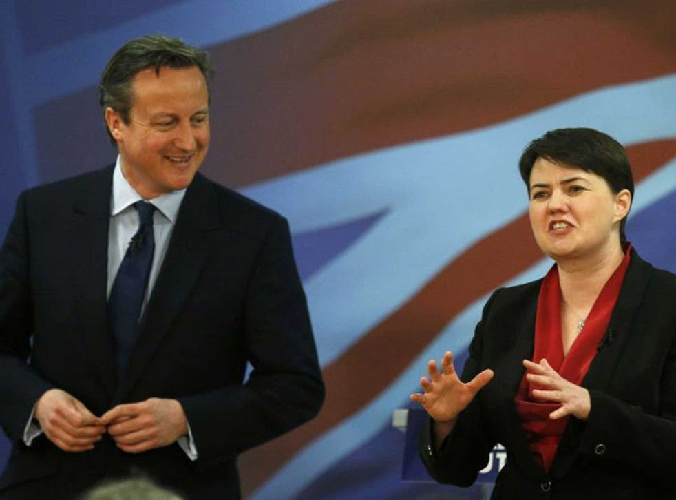 Prime Minister David Cameron listens to Scottish Conservative Leader Ruth Davidson at the launch of the Scottish Conservative manifesto