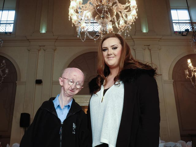 Alan Barnes with Katie Cutler, the woman who helped him raise over £330,000 after a mugging left him with a broken collarbone