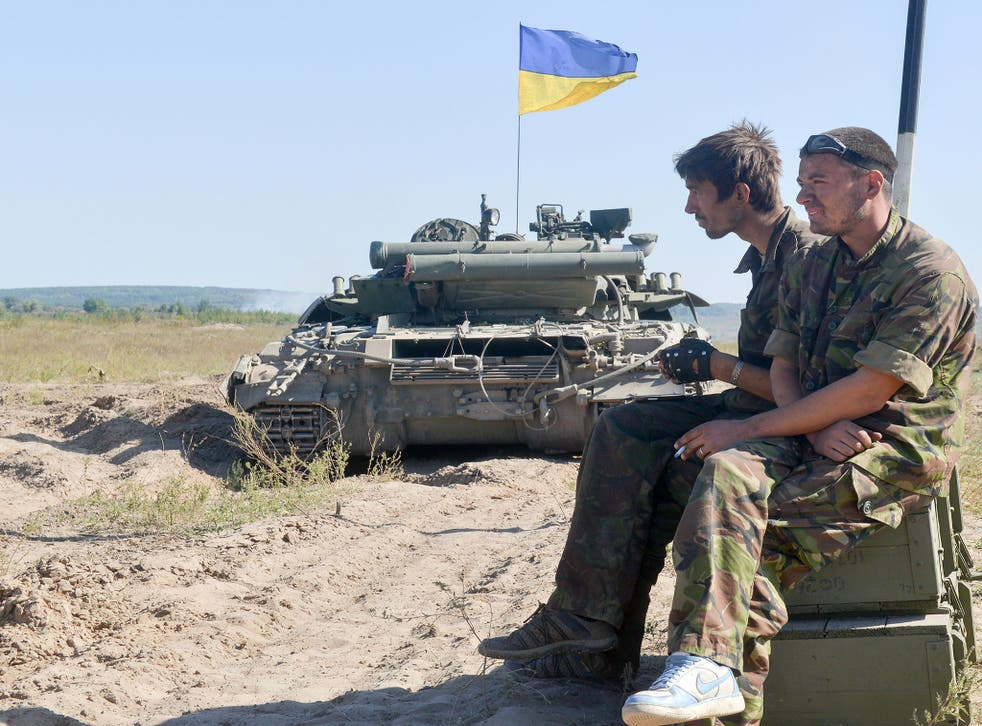 Ukraine National Guard soldiers take part in a drill on a firing ground in the Kharkiv region on 18 September 2014.