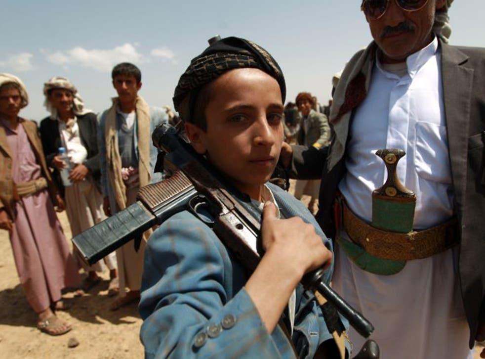 (FILE PHOTO) A Yemeni boy loyal to the Houthi rebels