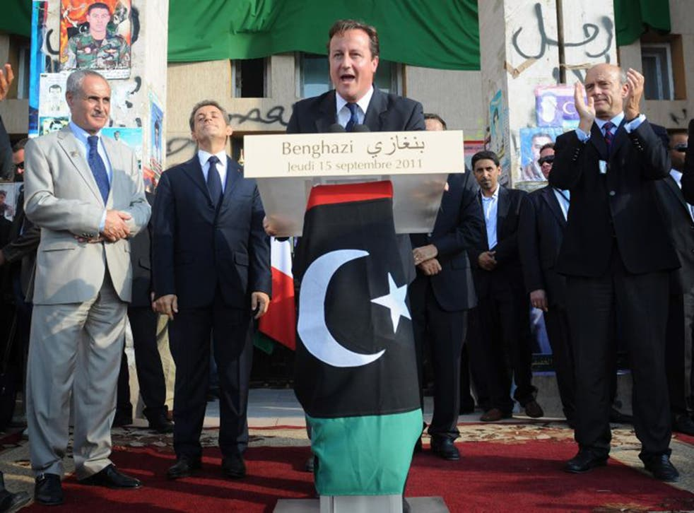 Hollow victory: David Cameron in Benghazi in 2011 after Gaddafi's downfall