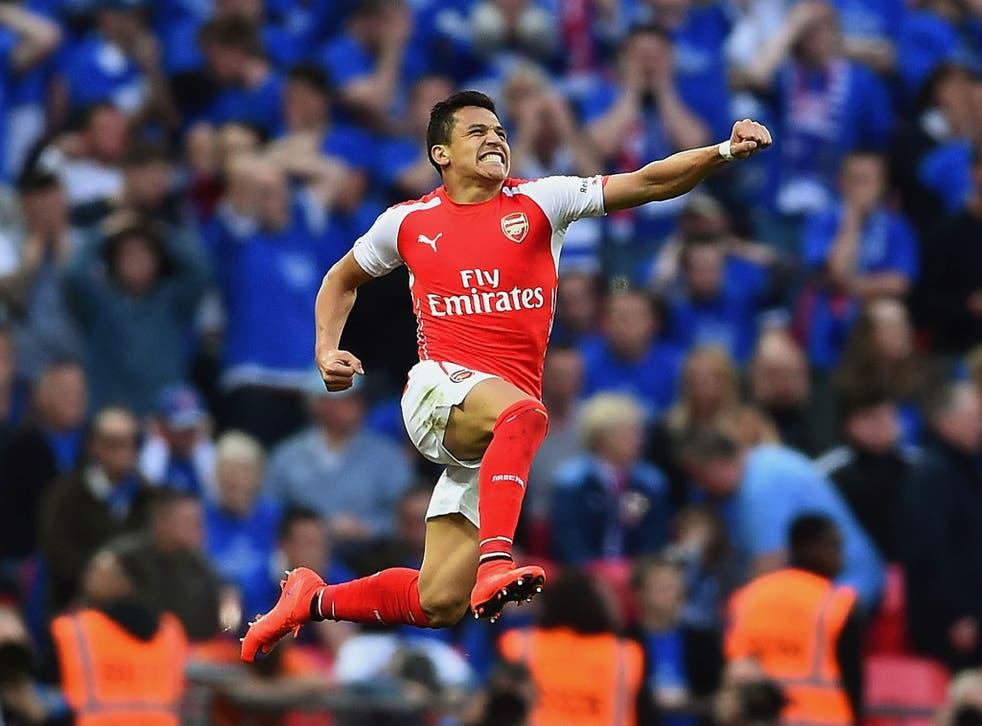 Alexis Sanchez celebrates scoring a second for Arsenal against Reading