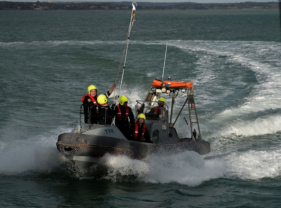 Rescuers train to board the Iceland's patrol vessel Tyr, on February 6, 2015 in the port of Pozzallo in Sicily