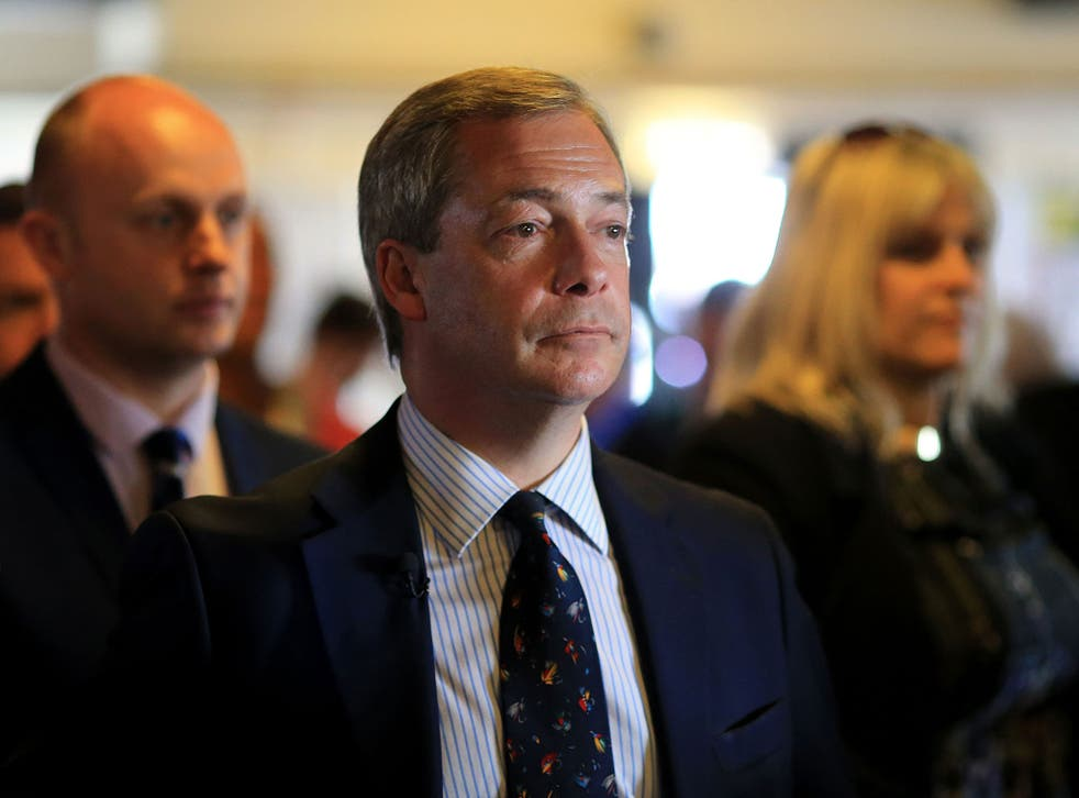 Ukip leader Nigel Farage waits to speak at a public meeting in Cliftonville, Kent, as he continues his campaign for the South Thanet seat at the General Election