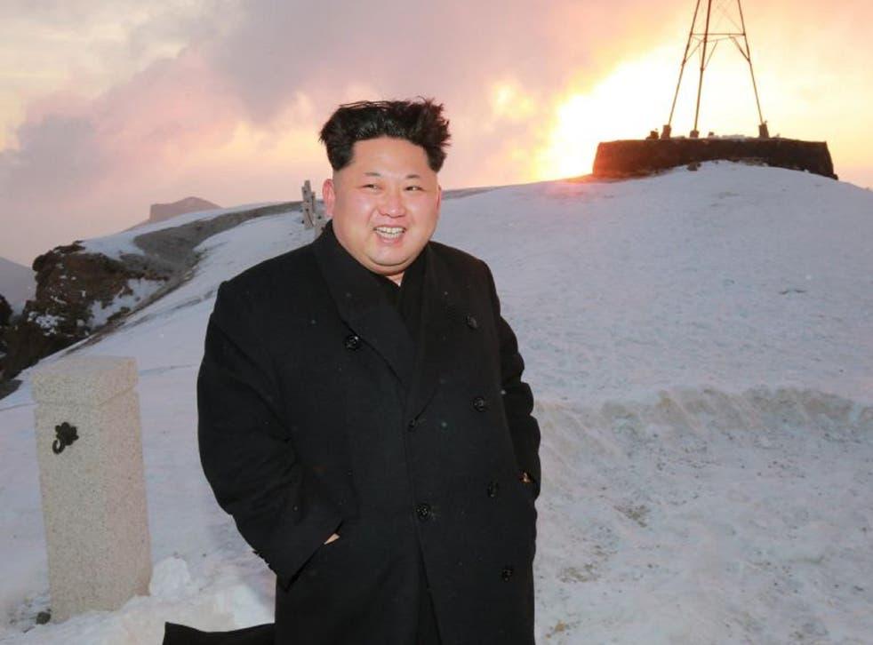 Kim Jong-un posing on top of Mount Paektu in North Korea