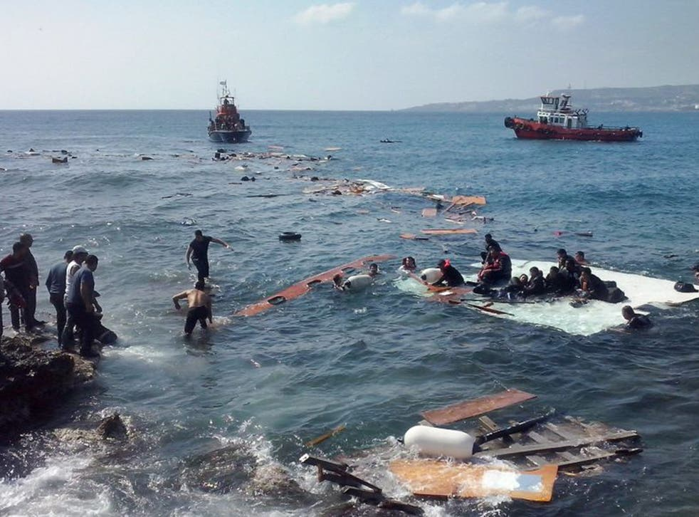 Survivors cling on to debris after the boat they were in ran aground at Zefyros beach in Rhodes on Monday