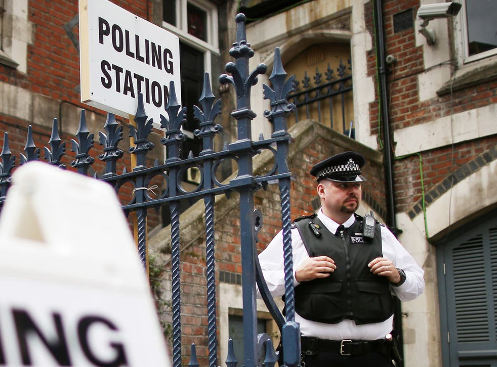 A police officer outside a polling station in Tower Hamlets during last May's local elections following accusations of voter intimidation in the area