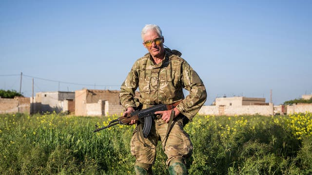 A 67-year old foreign fighter from Canada, nick-named by Kurdish fighters as Hewal Zinar, poses for a photo on April 19, 2015