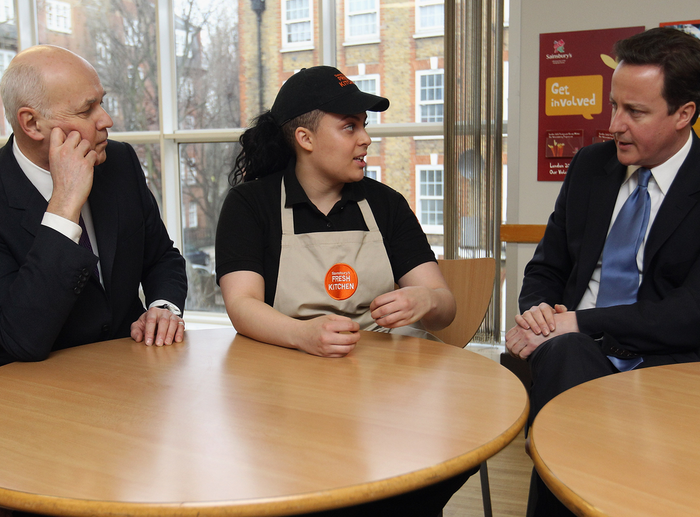 Iain Duncan Smith and David Cameron talk to a Sainsbury's worker to try and figure out how buying groceries works