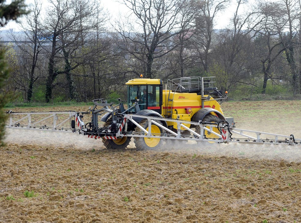 A field is sprayed with pesticides