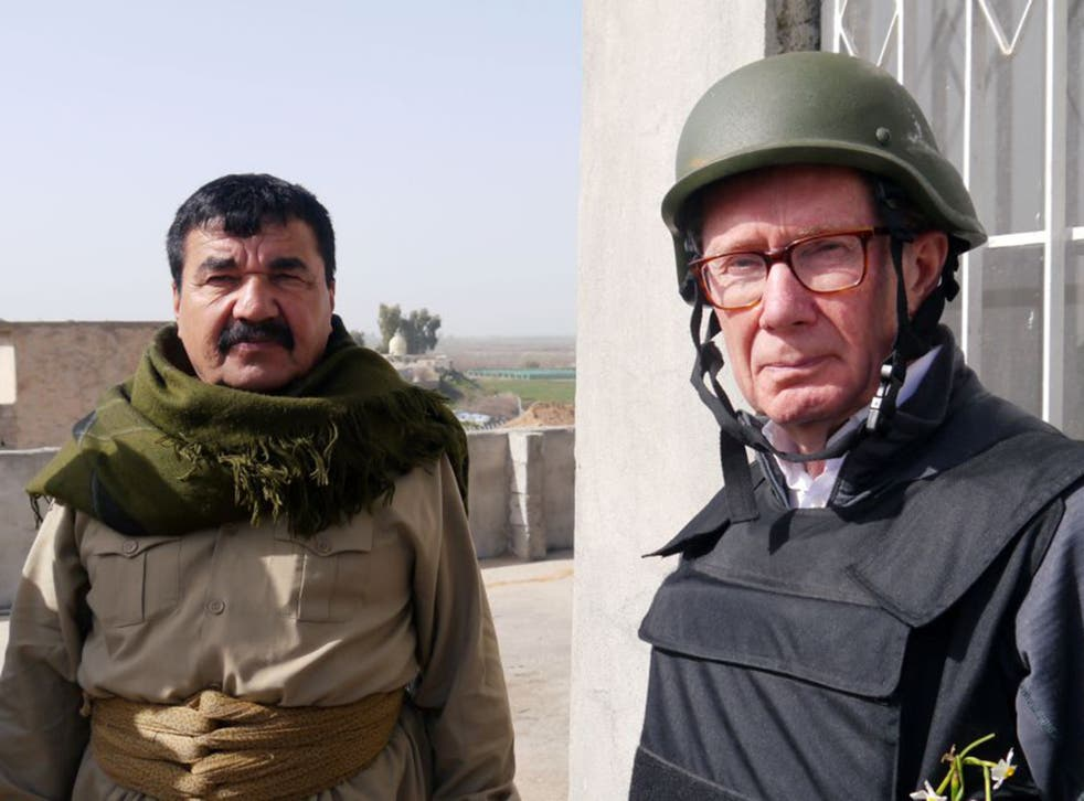 Frontline: Peter Taylor, right, meets a Kurdish Peshmerga fighter in Guer, northern Iraq